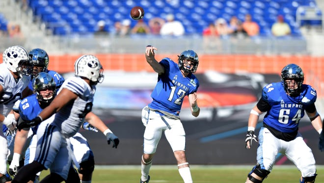 Memphis quarterback Paxton Lynch fires a pass on the way to a Tigers victory.