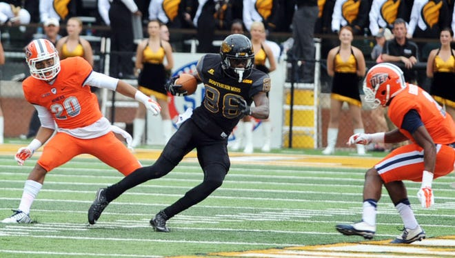 Southern Miss wide receiver Mike Thomas runs the ball after a catch on Saturday during the Golden Eagles' game against UTEP at M.M. Roberts Stadium.