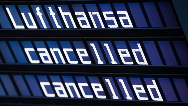 The words 'Lufthansa' and 'cancelled' on a display board at the Munich airport on Nov. 29, 2016.