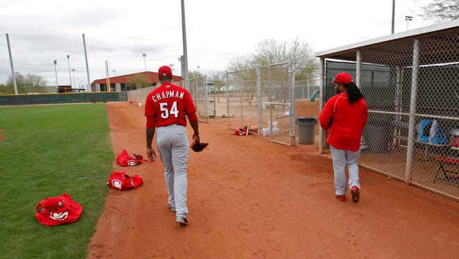 Reds closer Aroldis Chapman (left) and starting pitcher Johnny Cueto walk to the dugout following their live batting practice throw sessions during 2015 spring training.