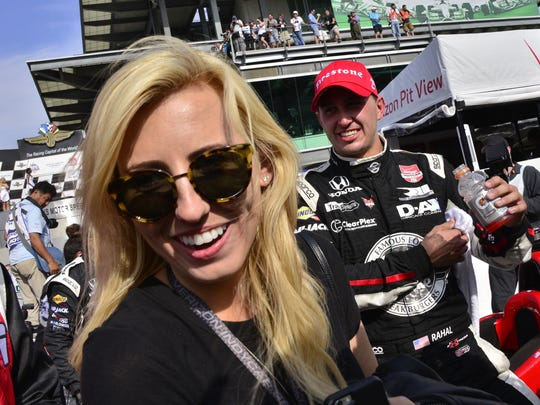 Courtney Force and finance Graham Rahal celebrate Rahal's second place finish in Saturday's Angie's List Grand Prix.
