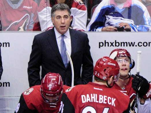 Arizona Coyotes head coach Dave Tippett looks on during