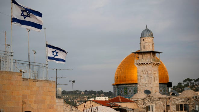 Israeli flags fly near the Dome of the Rock in the Al-Aqsa mosque compound on December 5, 2017.