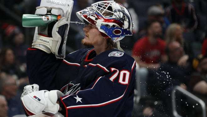 Blue Jackets goalie Joonas Korpisalo sprays his face with water on March 1, 2020 at Nationwide Arena. Korpisalo is off to a slow start in training camp for the postseason, allowing 13 combined goals in intra-squad action Monday and Tuesday.