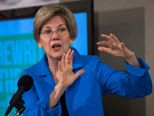 Elizabeth Warren addresses a news conference in Washington