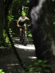 """Simon Lewis, 16, will compete in a national mountain bike race this week. """"It's all about motivation. You gotta really want it. No one's really pushing me for it,"""" he says."""