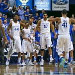 Kentucky's Karl-Anthony Towns celebrates as Trey Lyles walks towards his teammates in the first half in the Wildcats' 84-67 win over Arkansas Saturday. By Matt Stone, The Courier-Journal February 28, 2015