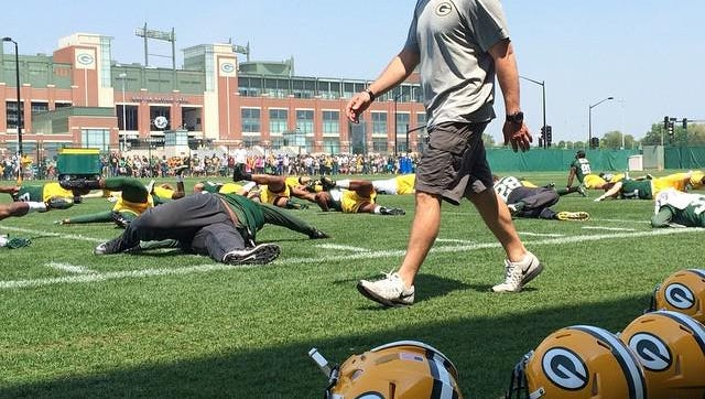 Green Bay Packers players stretch before the first open practice of organized team activities at Clarke Hinkle Field on Thursday, May 28, 2015.