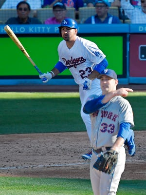 Los Angeles Dodgers' Adrian Gonzalez, top, hits a solo home run as New York Mets starting pitcher Matt Harvey reacts during the fifth inning of a baseball game, Saturday, July 4, 2015, in Los Angeles. (AP Photo/Mark J. Terrill)