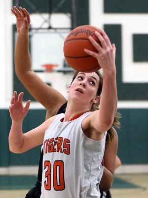 In this photo taken March 5, 2015, Chagrin Falls' Hallie Thome spins to the basket for a shot in the girls Division II district final high school basketball game in Macedonia, Ohio.