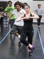 Alizaya Santiago rehearses during dance ensemble class