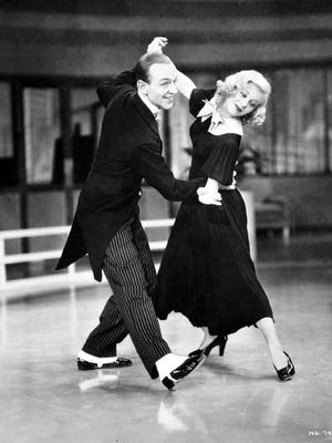 """Fred Astaire and Ginger Rogers dance in the 1936 RKO film """"Swing Time."""""""