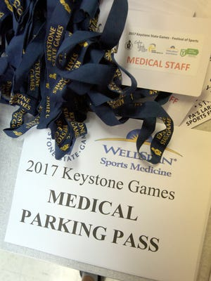 Volunteers amassed medical supplies, credentials and parking passes during a briefing for Keystone State Games volunteer physicians at the York Fairgrounds Thursday, July 27, 2017. It is the third year in a row that a group from WellSpan has administered medical coverage for the event which runs through Sunday, July 30. Bill Kalina photo
