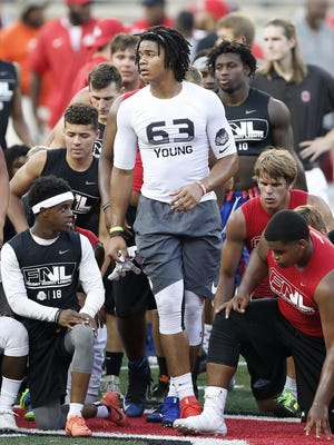 Future All-America defensive end Chase Young and other recruiting targets are shown at Ohio State's Friday Night Lights in 2016. The coronavirus pandemic has forced the Buckeyes and other college football programs to abandon evaluation camps this year. Coaches now must rely on high school game tape.