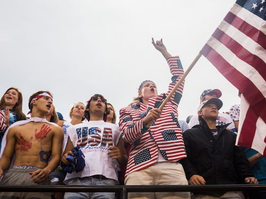 T.L. Hanna senior Matthew Justice (center) celebrates the school's first home football game of the season by dressing in patriotic attire Friday at the T.L. Hanna vs. Boiling Springs football game.