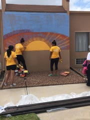 Team PeaceKeeper's painted Casa Arena Blanca Nursing Center as part of their Big Give project this year.