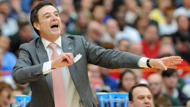 Louisville Cardinals head coach Rick Pitino reacts to a play during the second half against the Michigan State Spartans in the finals of the east regional of the 2015 NCAA Tournament at Carrier Dome.