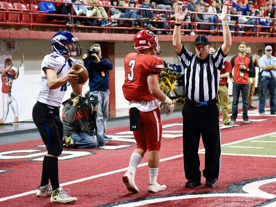 A referee indicates that Gregory running back Jayd