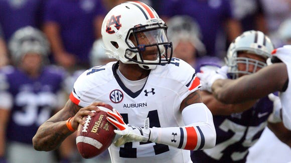 Auburn Tigers quarterback Nick Marshall was 9-for-18 for 118 yards with a touchdown and interception in the first half.