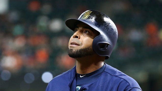 Seattle Mariners designated hitter Nelson Cruz reacts after striking out Tuesday during the fourth inning against the Houston Astros at Minute Maid Park.
