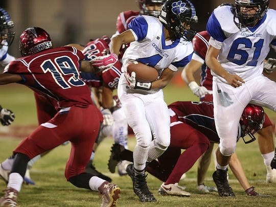 Cathedral City's Timothy Miller Jr. carries the ball against La Quinta, November 4, 2016.