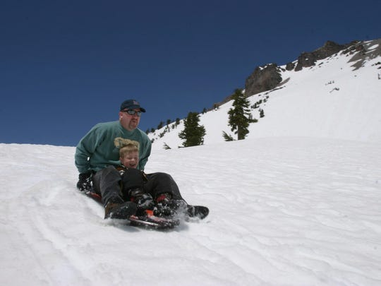 People enjoy sledding at Lassen National Park.