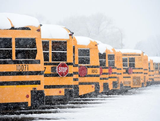 File photo of Washoe County school buses in the snow.