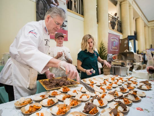 Chef Tom Hannum of Buckley's Tavern prepares his dish, seared Korean Beef with sticky rice and kim chee, at the 20th Annual Celebrity Chefs Brunch held at the DuPont Country Club in Wilmington on Sunday afternoon.