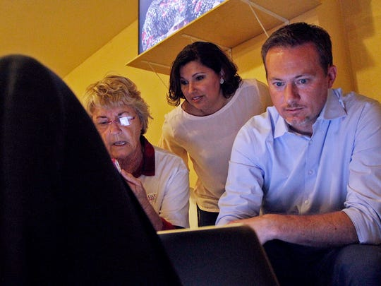 Michael Cloud, Republican candidate for Texas' 27th Congressional District, watches early votes come in with his wife, Rosel Cloud, and campaign field coordinator, Brenda Cash.