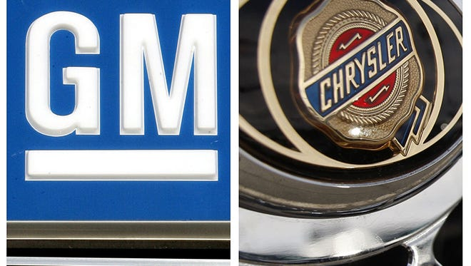 In this combo made with file photos, logos for General Motors and Chrysler are shown. Automakers should not expect a quick turnaround in consumer demand, auto industry analysts said Tuesday, Jan. 13, 2009, predicting the struggling economy could lead to some consolidation in the industry. (AP File Photos)