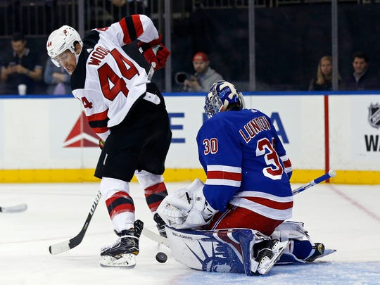 New Jersey Devils left wing Miles Wood (44) has his shot stopped by New York Rangers goalie Henrik Lundqvist (30) during the first period of an NHL preseason hockey game Wednesday, Sept. 20, 2017, in New York. (AP Photo/Adam Hunger)