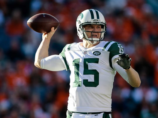 New York Jets quarterback Josh McCown (15) drops back to pass in the second quarter against the New York Jets at Sports Authority Field at Mile High.