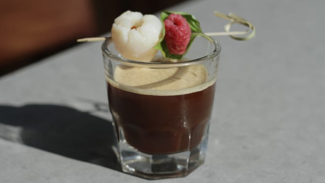 The Taipei Shake served by Peregrine in Washington, D.C., starts with strong Japanese-style cold-brewed coffee combined with lychee syrup, and served with a fresh raspberry and basil.