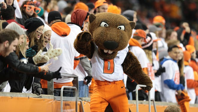 Nov 29, 2014; Corvallis, OR, USA; Oregon State Beavers mascot cheers with the fans against the Oregon Ducks at Reser Stadium.
