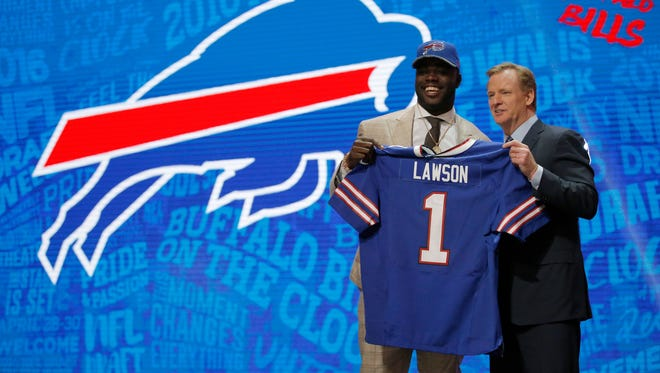 Shaq Lawson of Clemson holds up a jersey with NFL Commissioner Roger Goodell after being picked #19 overall by the Buffalo Bills.
