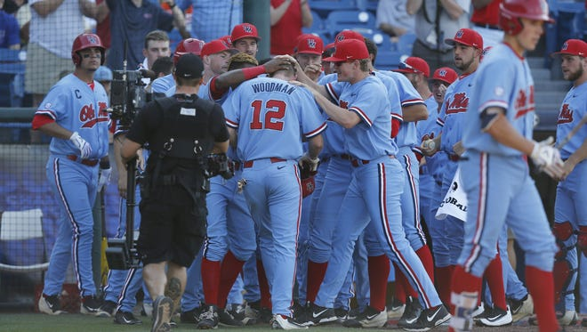 Center fielder J.B. Woodman celebrates with his teammates after he hits a solo home run in the third inning against Vanderbilt during the Southeastern Conference NCAA college baseball tournament at the Hoover Met, Thursday, May 26, 2016, in Hoover, Ala. (AP Photo/Brynn Anderson)