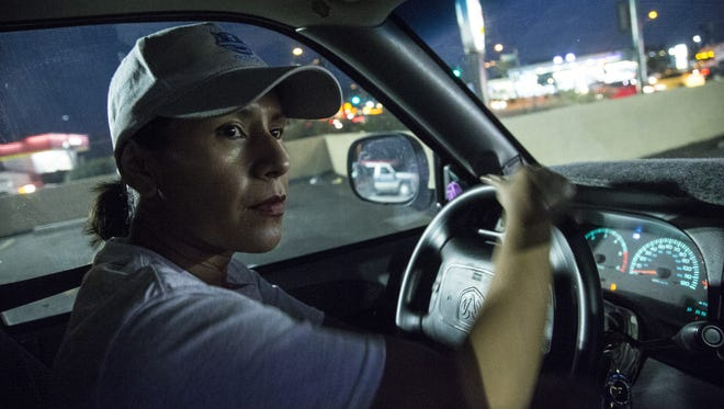 Rosa Pastrana looks out from inside of her truck before starting her Block Watch patrol in the neighborhoods around 51st Ave and McDowell Road on March 6, 2017 in Phoenix, Ariz.