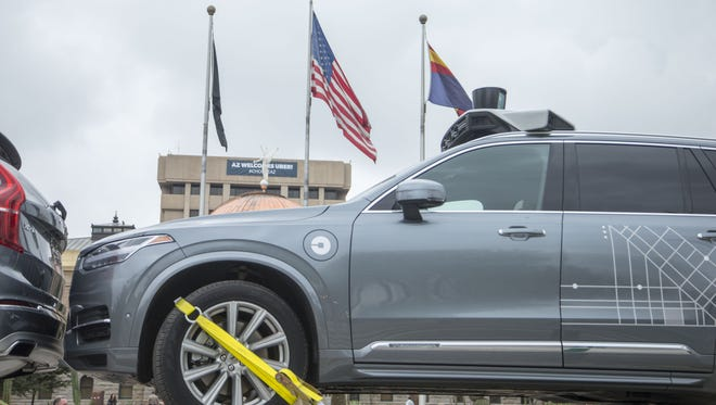 """One of Uber's self-driving Volvos is delivered to the state Capitol in Phoenix for a press conference during which Gov. Doug Ducey introduces the company's program to Arizona on Dec. 23, 2016. Uber return its cars to roads in Tempe Monday following an accident Friday that prompted the ride-hailing company to temporarily """"ground"""" its fleet of Volvo SUVs."""
