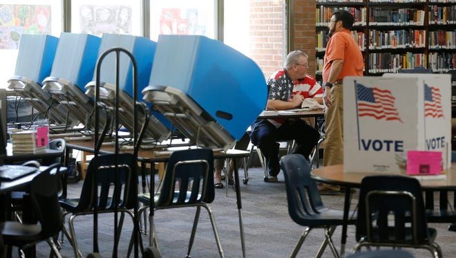 Early voting continued at J. M. Hanks High School Thursday morning with slow lines.