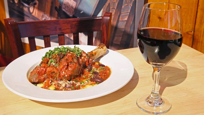 Braised Strauss Lamb Shank, served with a red wine, Franco Serra Barbera D'Alba, at Ristorante Lagoin Pewaukee.