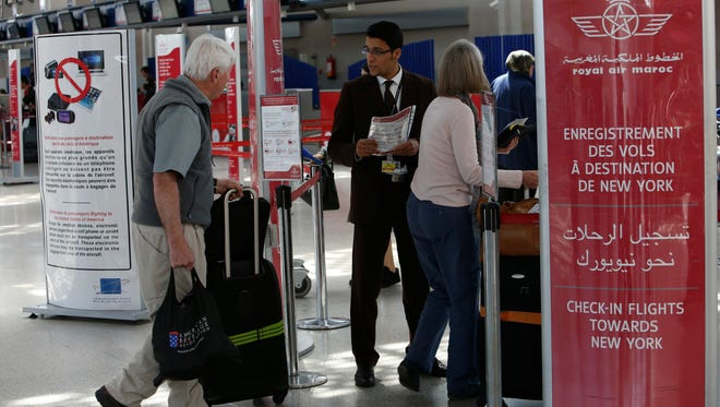 Airport staff inform passengers at the check-in area at Casablanca Mohammed V International Airport, Morocco, on March 29, 2017.