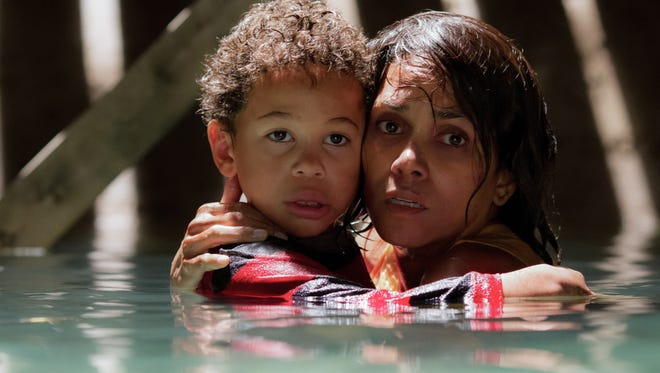 """Karla (Halle Berry) and her son (Sage Correa) hide in """"Kidnap."""""""