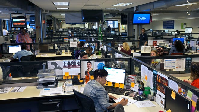 Workers repond to customers calls at the TWC customer call center in Milwaukee.