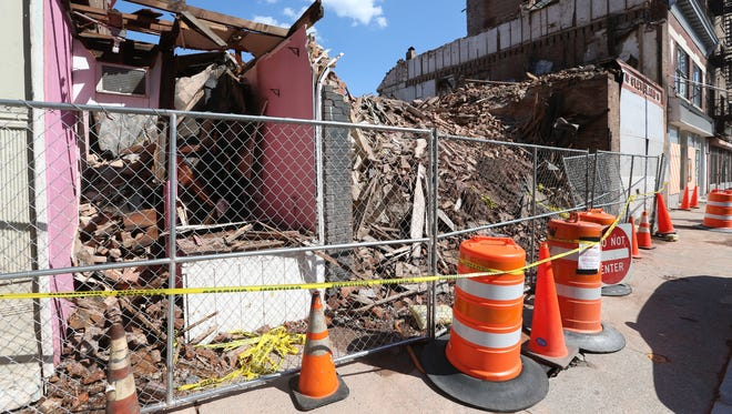 Fences put up at the site of the demolished buildings on Academy Street in the City of Poughkeepsie on June 29, 2018.