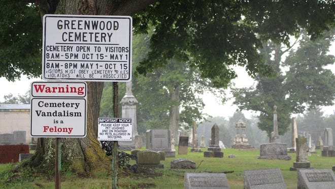 Following heavy rain this week, bones from an old grave surfaced in Greenwood Cemetery.