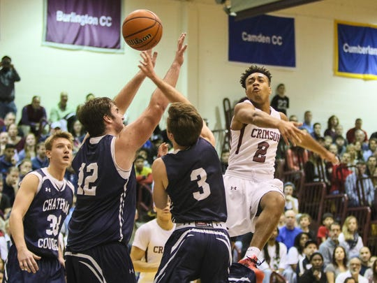 Morristown-Beard's Zachary Dees goes to the basket as Chatham blocks during the first half of the Morris County Tournament boys basketball final at County College of Morris in Randolph on Saturday.