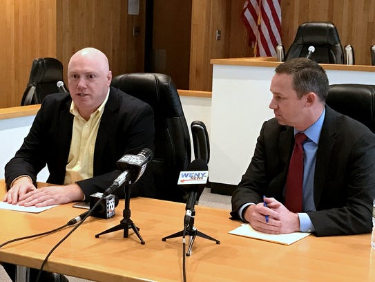 Corning City Manager Mark Ryckman, left, discusses