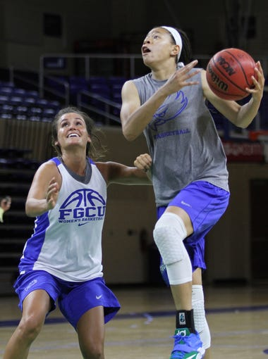 FGCU's Whitney Knight, right, is defended by teammate