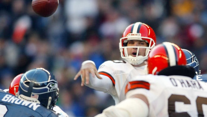 Cleveland Browns quarterback Kelly Holcomb passes during the second quarter against the Seattle Seahawks in Seattle Sunday Nov. 30, 2003.