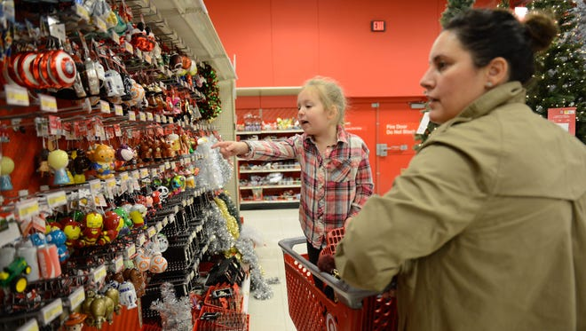 Jamie Davis of West Caldwell and her daughter Grayson, 3, look through Christmas ornaments at the Fairfield Target on Black Friday, Nov. 25.
